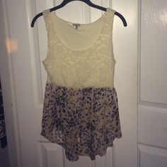Top from Charlotte Russe Top with whit lace top and floral high to low bottom, Charlotte Russe size medium Charlotte Russe Tops Blouses