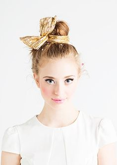 Wrap your top knot bun with a bow for a cute addition.