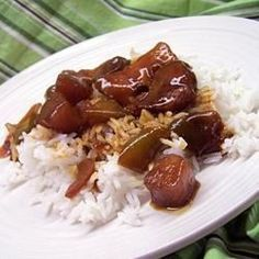 """Slow Cooker Sweet and Tangy Chicken I """"Tangy is the perfect word for this chicken! It's great! My mom puts hers over potatoes, but rice is great too!!!"""""""