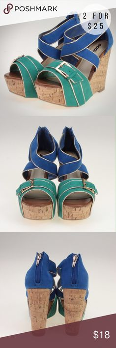 """Blue & Green Platform Sandal Wedges These adorable wedges feature a belt style buckle on each shoe with gold piping around a faux suede material for the straps. The wedge is cork style on a 2"""" platform with a 5"""" total heel. These shoes also have a zipper up the back to be sure they stay securely on your feet. They would pair perfectly with any spring or summer outfit! These are made of all man made materials. Soda Shoes Wedges"""