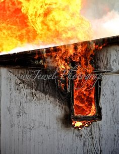 This amazing photo of a burning house was taken in 2014 during a training event for a volunteer fire department in Alabama.  The house was abandoned and unsafe to live in, and the town donated it to the local fire dept. to be used for training on house fires. All personnel involved in the training event stayed safe, and burned the house down carefully.  This particular shot is of the thick flames and smoke billowing out through a back window and roof.  The photo is cropped to a 8 1/2 by 11…