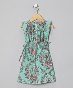 Richly patterned with little cinching ties at the side, this splendid stunner lends to effortless dressing with an easy slip-on silhouette and a stretchy shirred bodice.