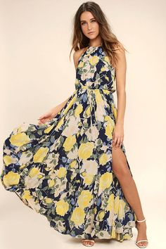 Cherish every special occasion spent in the Precious Memories Navy Blue and Yellow Floral Print Maxi Dress! Dreamy woven Georgette, with a navy blue, yellow, and green floral print, cascades from a drawstring, halter neck, to a sleeveless bodice with drawstring waist. Back keyhole. Maxi skirt with side slit.