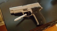 Sig Sauer P226 stainless. Waiting to cerakote and add an aim point Find our speedloader now! http://www.amazon.com/shops/raeind