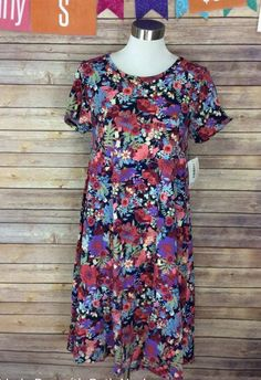 ba578a21f055d Lularoe Carly in this magical floral print! Normally floral is not my  season.