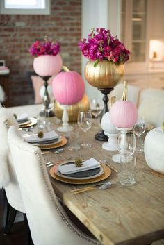 Pink and gold pumpkins are elevated on cake stands -- perfect for the kitchen, dining room, living room and family room! - I gold pumpkins! I had gold pumpkins at my wedding! Pumpkin Vase, Pumpkin Centerpieces, Gold Pumpkin, Centerpiece Ideas, Pumpkin Table Decorations, Table Centerpieces, Halloween Decorations, Baby Shower Fall, Girl Shower