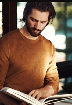 A man with a book...so hot