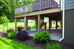 landscaping and stones under/around deck idea
