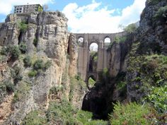 Ronda - Tajo Gorge & Puente Nuevo  © Robert Bovington  The bridge is hardly as new as its name implies - it was built over 200 years ago! It is the focal point of the town. It is a masterpiece of architecture and engineering but it took 42 years to build and special machines had to be invented to raise the huge solid stone blocks from the bottom of the gorge. Various vantage points on the bridge provide spectacular views of the gorge far below.  http://bobbovington.blogspot.com.es/