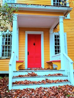 Yellow New England house and porch with red door and fall leaf covered white steps Craftsman Cottage, Craftsman Style, Porch Trim, Front Porch, Town And Country, Country Living, Porch Appeal, Taupe Paint, Transom Windows