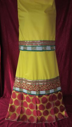Description - Amber yellow royal rida inspired from the 'Moghul Era' designed using pleated dobby motifs panel at the base of the lehenga along with gold embroidery, white moti and kundan work panels. Add this classy vintage look ensemble to your wardrobe !