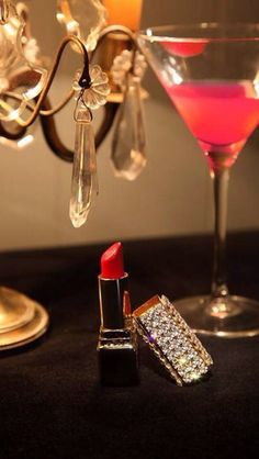 A woman's favorite things before heading to that upscale cocktail party. Grab your lipstick and cosmos ladies. #eventnight #luxury #gold #diamond