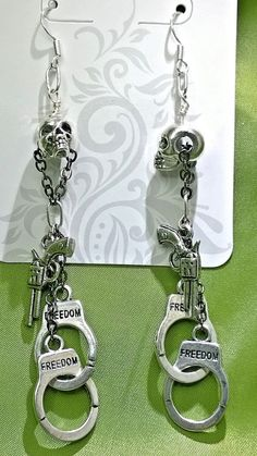 Rebel Without a Cause  Silver Skull Dangles with Gun by mistydlee, $10.00