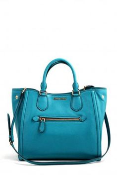 2585c165ff55 shopping bag by miu miu. Opened Tail bag made of leather in turquoise color.