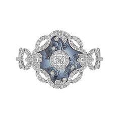 The Les Talismans de Chanel Fascinante bracelet in 18ct white gold is set with 277 brilliant-cut diamonds around a floral enamel design.