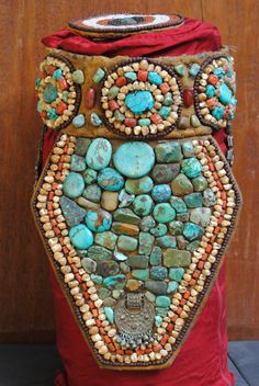 "A "" Perak "" of Ladakh, exellent condition for the age, found in Leh in the twenties and it's remained in a private collection until recently. The set of jewelry (tiara and necklaces as well as other ornaments) worn by the Lama Buddhist monks are unique. Richly decorated with semi-precious stones such as turquoise, cornelian, and coral, which cannot be found in Ladakh's regions but are brought by the Newaris merchants from the valley of Katmandu."