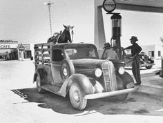 HEADED TO WORK - A cowboy fuels up his pickup truck at a filling station before heading to the pasture.