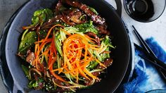 Neil Perry's - Bibimbap with beef and onions Simple yet flavourful, bibimbap is a hearty warmer for the cooler months. Chicken thigh is a good substitute for the beef. Onion Recipes, Wine Recipes, Cooking Recipes, Lamb Recipes, Keto Recipes, Healthy Recipes, Korean Dishes, Korean Food, Korean Recipes