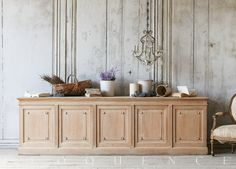 Antique Counter Spectacular antique drapery shop counter in stripped bare oak from Lille, France. Beautiful classic shape and proportions with elegantly paneled door fronts. Reverse has solid, generously sized drawers for storage of linens, crockery, or whatever you like.