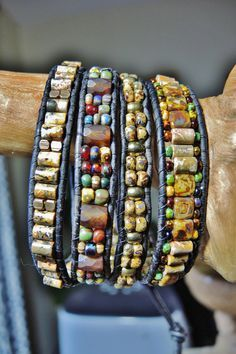 four wrap leather bracelet: leopardskin jaspar tube beads, czech picasso tile and old world mix beads, brass and bronze beads and button, dark brown leather, black 12 pound wildFire beading cord