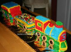 Homemade 3D Train Birthday Cake Idea: I was so pleased with how adorable this 3D Train Birthday Cake Idea turned out. My 3 year old is a train fanatic! I used a Wilton Cake mold for the engine
