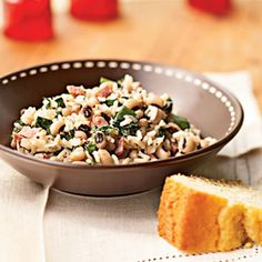 Hoppin' John: We usually use kale instead of mustard greens. It's the black-eyed peas that are most important for New Year's Day. Enjoy!
