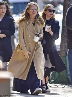 Lovely in layers! Ashley and Mary-Kate (right) Olsen enjoyed a coffee on an outing in New York City on Monday wearing oversized clothes