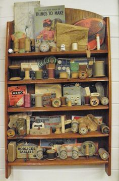 Vintage sewing items displayed on a small wooden wall shelf. Vintage Sewing Notions, Antique Sewing Machines, Vintage Sewing Patterns, Vintage Sewing Rooms, Sewing Spaces, My Sewing Room, Sewing Box, Dress Sewing, Vintage Accessoires