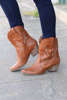 """From Very Volatile, the 'Markie' western cowgirl boot / bootie is a must have! Tanin color with light brownstitching and gold randon the heel. These are perfect for wearing with jeans, dresses, or shorts! Heel measures about 2"""" at highest point. Pull on. Very comfortable! Model is wearing size 8, which is her true size."""
