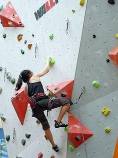girl practicing with natural mountain climbing
