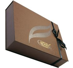 Title: Promotional box Client: Tynan D'arcy Materials: Book cloth paper, stain ribbon, grey board Processes: Foil block, deboss, hand cover