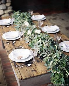 greens tablescape on a rustic wooden table create a beautiful rustic table design #rusticweddings #brides #centerpieces