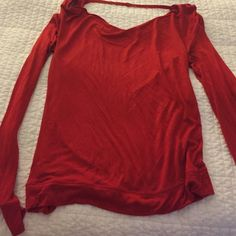 Cut out back shirt Long sleeve, cut out at top of back. Like new, material is soft. Best fit for size 0-2 Express Tops Blouses