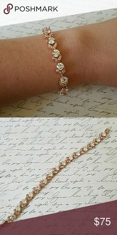 "Rose gold tennis bracelet Gorgeous bracelet! 15 carats of simulated cubic zirconia diamonds (lab created) Rose gold plated and stamped This is a stunning bracelet! 6.75"" Jewelry Bracelets"