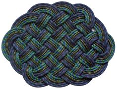 Mats made from knotted recycled fishing ropes. So cool. http://www.serpentsea.com/about
