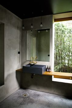 13 Ideas For Creating A More Manly, Masculine Bathroom // Anything industrial is a surefire way to make the bathroom more masculine. Here, a black sink, concrete walls and floor, and brass combine to create an industrial and masculine feeling bathroom. Man Bathroom, Brass Bathroom, Bathroom Interior, Modern Bathroom, Bathroom Ideas, Bathroom Designs, Zebra Bathroom, Bling Bathroom, Minimalist Bathroom