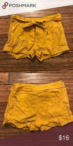 "F21 Yellow Bow Shorts Forever 21 yellow button up shirts with belted tie. 3 button closure (2 hidden) and approx. 1"" pre-sewn cuff. Approx. 2"" inseam while cuffed, 15"" across waist while laying flat and buttoned, and 11"" long. Shell 55% linen, 45% rayon. Lining 35% cotton, 65% polyester. Forever 21 Shorts"