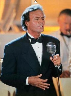Julio Iglesias - Epitome of romance! I like when he grabs his tie. Ooo la la