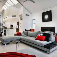 adorable-red-accents-decorating-ideas-in-2013-with-beautiful-modern-kitchen-and-modern-living-room-with-red-nuances-grey-sofa-red-sofa-red-sofa-cushion-white-floor-white-wall
