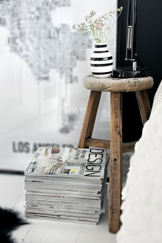 stacked magazines and un-hung floor art. My idea of perfect decorating.