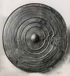 A beautiful bronze shield from the Late Bronze Age.   This large bronze shield  was discovered during peat-digging in a small kettle bog at Svenstrup in Himmerland.