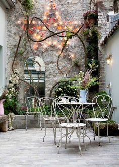 Best patio decorating ideas for A backyard guide to the essentials to make your outdoor space inviting, comfortable and functional. Read our expert tips for the perfect outdoor patio space. For more patio ideas go to Domino. Outdoor Rooms, Outdoor Gardens, Outdoor Living, Outdoor Decor, Outdoor Mirror, Small Courtyard Gardens, Courtyard Ideas, Hotel Paris, Paris Hotels