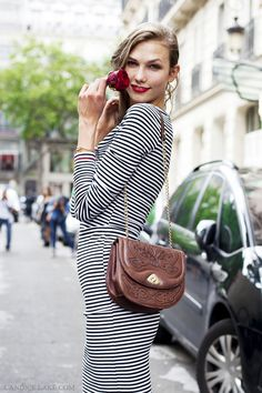 """Karlie Kloss, after Jean Paul Gaultier's couture show in Paris on the 4th of July with her red rose and """"All American"""" stripes."""
