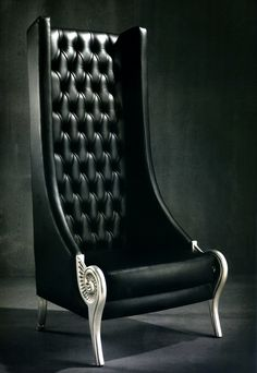 HIGHBACK ARMCHAIR A1205 - Highback armchair pictured in deep buttoned black leather.