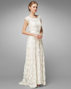 Carolina Lace Wedding Dress, Phase 8 Carolina Lace Wedding Dress Save 30% £385.00 WAS £550.00 ref: 201965106  This beautiful embellished lace design wedding dress is the epitome of romance. A floor length dress with tapework hem detail, lined lower half, high rise neck, and cap sleeves. The perfect dress for your wedding day.