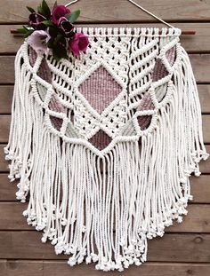 A personal favorite from my Etsy shop https://www.etsy.com/listing/527229677/macrame-wall-hanging-weaving-wall