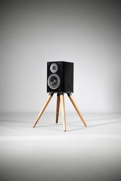 Pair of speaker stands, legs in solid wood and solid support made of galvanized iron.  It may be tilted or straight, the user can choose the tilt.  If another height required, please ask  dimensions  Support 20 cm (8 in) x 20 (8 in) cm. height 34 cm (13 in)