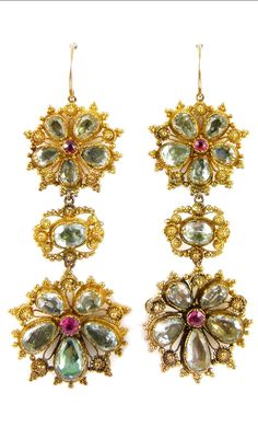 *Pair of 19th century aquamarine and spinel cannetille gold flowerhead pendant earrings, c.1830, designed as two graduated five-petal clusters, the larger one below, a single stone aquamarine in between, each flower formed by graduated pear shaped aquamarine petals and with a circular cut spinel highlight to centre, cannetille bead and wirework borders, close set in gold Length 6.5cm