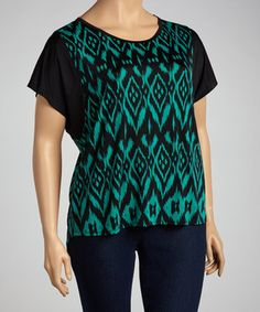 Both elegant and edgy, a studded piece completes a most fashionable ensemble. Slip into this pretty, dolman piece for a look that can't be beat.