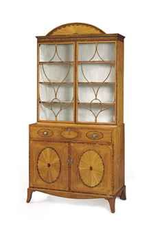 A GEORGE III SATINWOOD AND MARQUETRY SECRETAIRE-BOOKCASE ATTRIBUTED TO GILLOWS, CIRCA 1780 The fan-inlaid arched cornice above a pair of a...